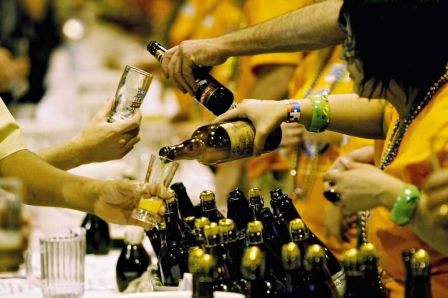 Vendors pour beer at the 2010 Great American Beer Festival in Denver. More than 400 breweries are expected to attend this year's festival, which sold out its 40,000 tickets in just a few days.