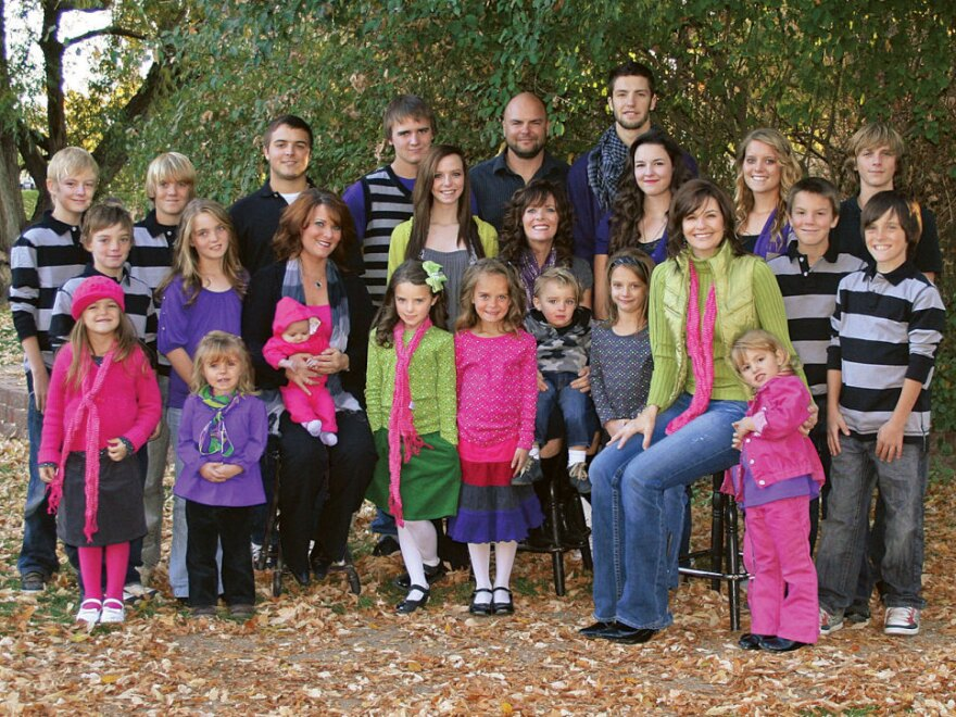 <p>Joe, Alina, Vicki and Valerie Darger are raising 23 children together. (Two children, Sam and Victoria, are not shown.)</p>