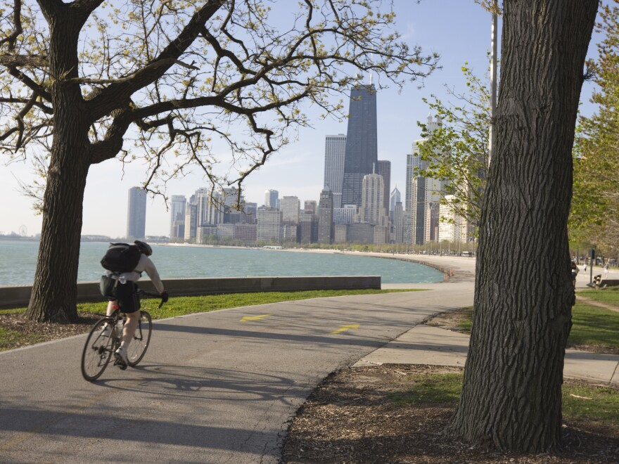 A cyclist by Lake Michigan shore in Chicago. Biking to work is associated with higher levels of well-being.