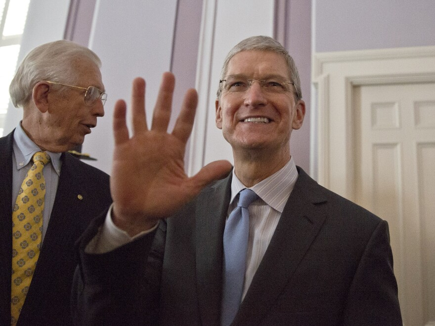 Apple CEO Tim Cook waves to a crowd before he is honored by the Alabama Academy of Honor at the Alabama state Capitol on  Monday.