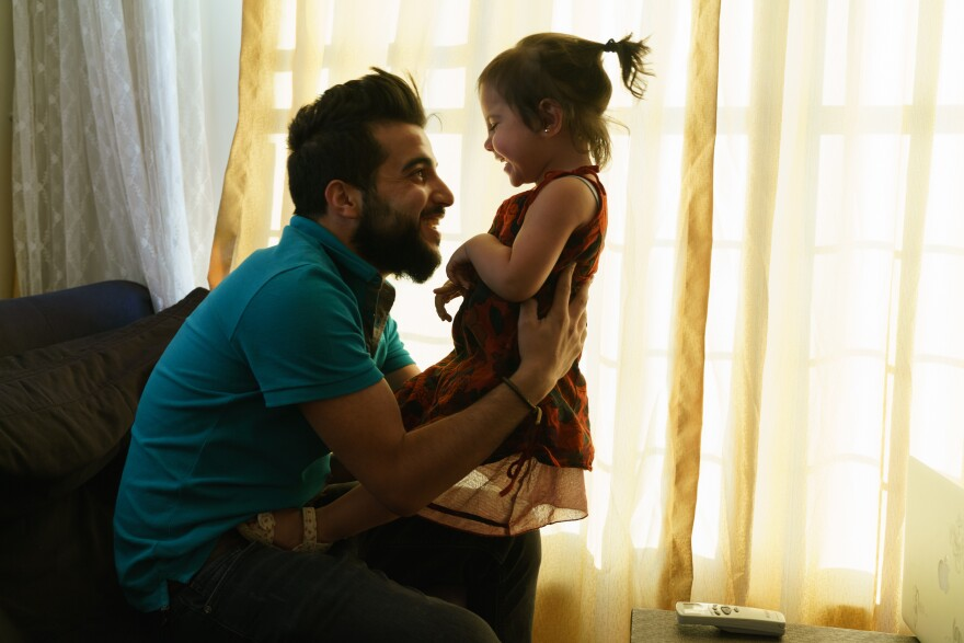 "Aref al-Krez, a 24-year-old Syrian refugee living in Gaziantep, Turkey, plays with his daughter Perla, 2, who was born in Turkey. Turkey considers the refugees to be ""guests"" and it is extremely difficult to obtain the paperwork needed to build new lives."