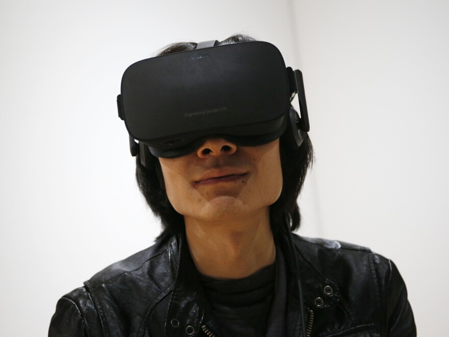 Peijun Guo wears the Oculus Rift VR headset at the Oculus booth at CES International, Wednesday, Jan. 6, 2016, in Las Vegas