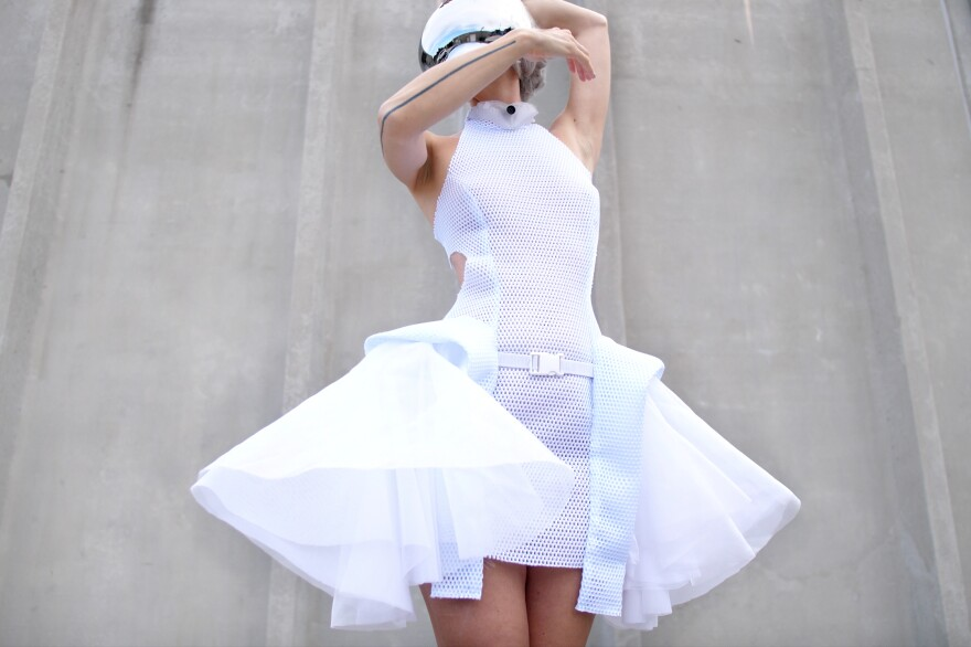 """the """"Proximity dress"""", which stretches to strengthen social distancing when someone gets too close."""