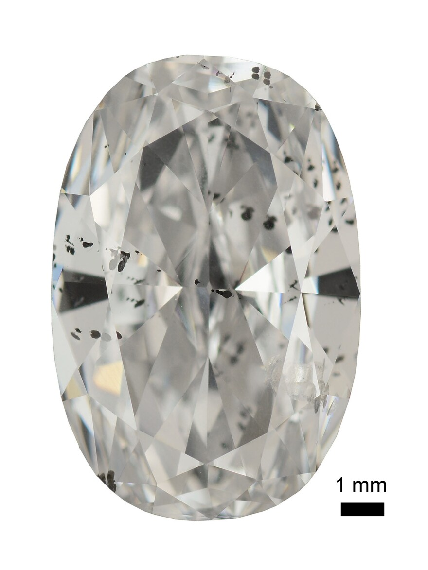 Big diamonds like this one can contain tiny bits of metal from far underground, visible as black spots inside the gem.
