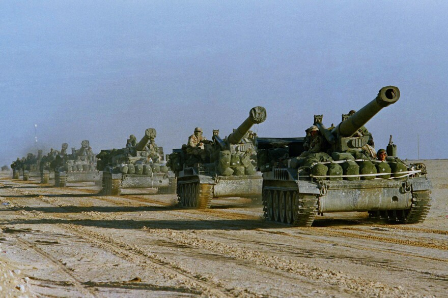 U.S. Army howitzers in Saudi Arabia head toward the Kuwait border in 1991, part of the effort to drive the Iraqi military out of Kuwait. The U.S. military has been involved in Iraq almost nonstop for more than two decades.