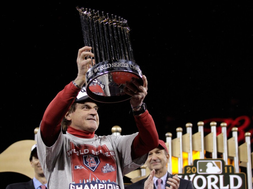 <p>Cardinals manager Tony La Russa celebrated with the World Series trophy Friday night in St Louis.</p>