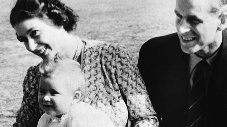 Prince Charles at 8 months old with his parents, Princess Elizabeth and the Duke of Edinburgh, on July 18, 1949, in Ascot, England.