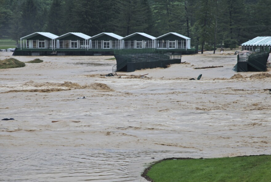 Flooding on the 17th green of the Old White Course at the Greenbrier resort in White Sulphur Springs, W.Va. Severe flooding hit the area that was scheduled to host a PGA Tour event in two weeks.