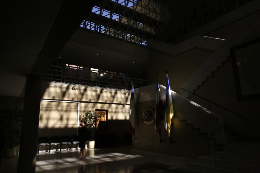 """A guard inside the National Congress of Chile, in Valparaiso. In 2016, the Chilean Congress passed <em>gratuidad —</em> """"free college"""" — by a vote of 92-2."""