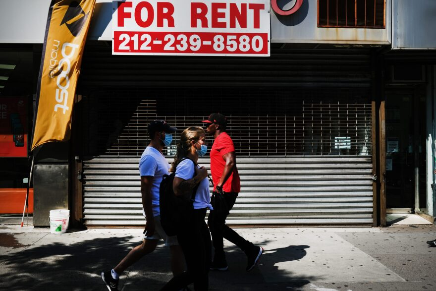 People walk by a closed business on July 21, 2020 in the Brooklyn borough of New York City. (Spencer Platt/Getty Images)