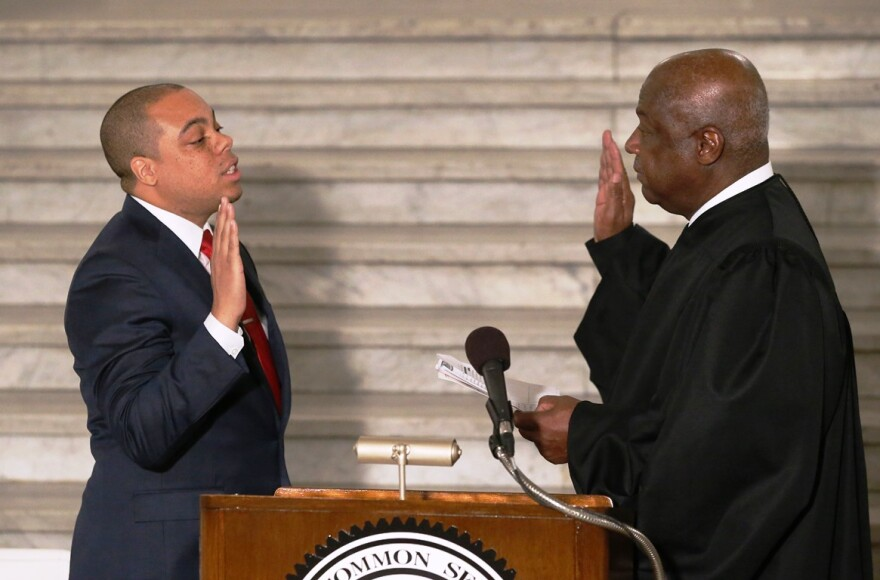 Michael Butler takes the oath of office for the office of Recorder of Deeds for the City of St. Louis from The Honorable Ronnie L.White, U.S. District Judge, Eastern District of Missouri, in the rotunda of City Hall on Jan. 2, 2018.
