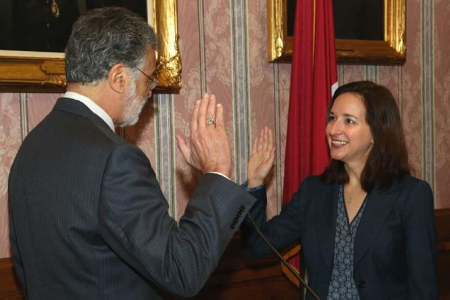a photo of Cleveland Mayor Frank Jackson swearing in Persis Sosiak as health commissioner