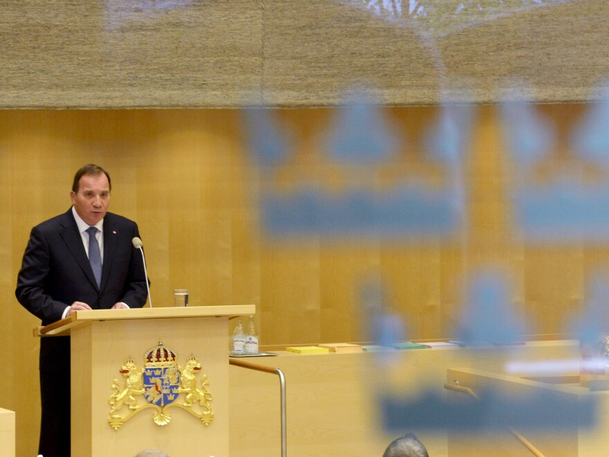 Swedish Prime Minister Stefan Lofven announces his new government during a Parliament session in the capital, Stockholm, on Friday.