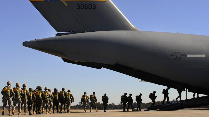 Airmen prepare for a parachute jump at Moody Air Force Base in Georgia in this 2009 photo.