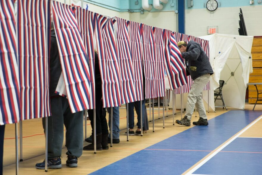 Voters fill out their ballots at the Broken Ground School during the presidential primary in Concord, New Hampshire.