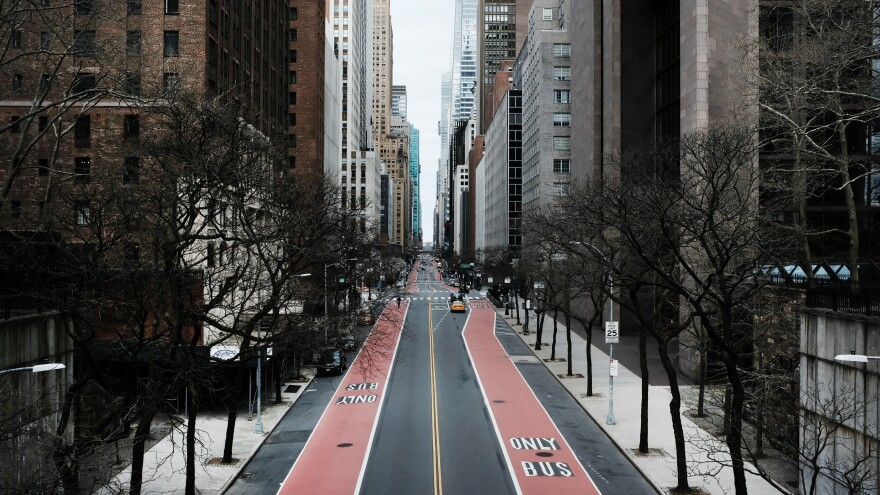 In New York City, 42nd Street stands mostly empty as much of the city is void of cars and pedestrians over fears of spreading the coronavirus.