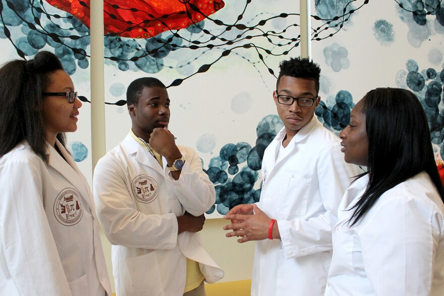 Academy participants Jayleen Gonzalez, Donovan Forrest, Kimon Chapman and Kaviona Donaldson, left to right, talk during a tour of the St. Louis Cortex Innovation Hub on July 23.