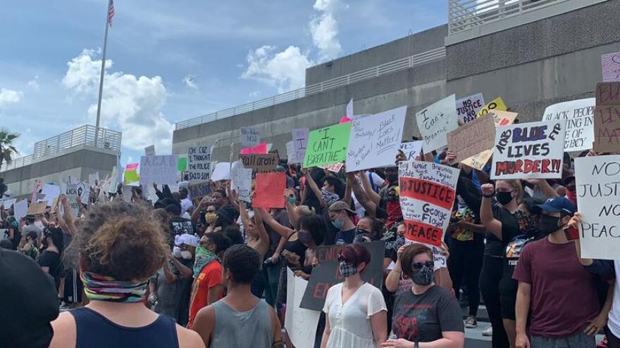 Protestors filled the steps of the Jacksonville Sheriff's Office in Downtown Jacksonville Saturday.