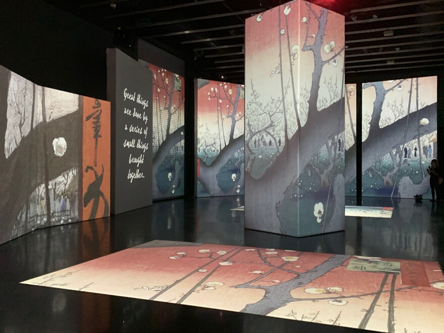 Scenes from one of Van Gogh's Japanese-inspired paintings appear on screens in the Van Gogh Alive exhibit.