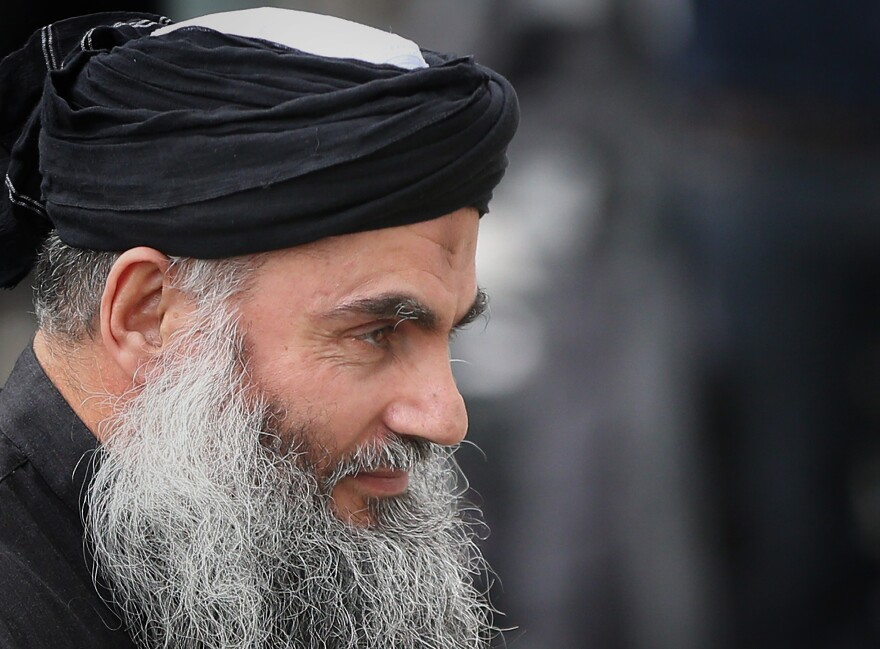 Muslim Cleric Abu Qatada arrives home after being released from prison in London on Nov. 13, 2012.