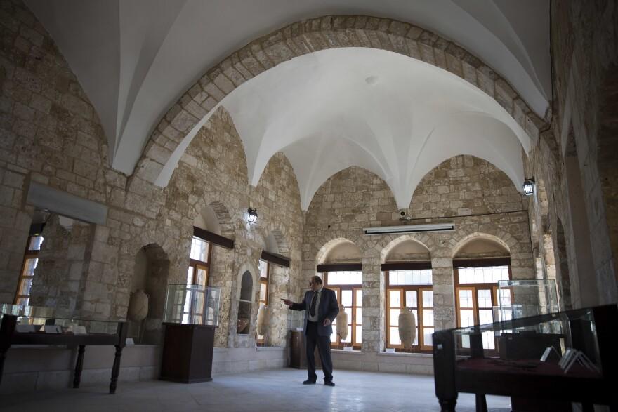 Hassouna stands inside Pasha's Palace in Gaza City.