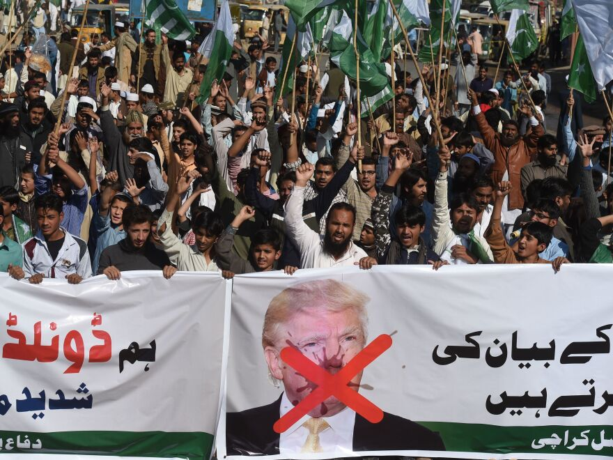 """Activists of the Difa-e-Pakistan Council shout anti-U.S. slogans at a protest in Karachi on Tuesday. Pakistan summoned the U.S. ambassador after President Trump lashed out at Islamabad with threats to cut aid over """"lies"""" about militancy."""