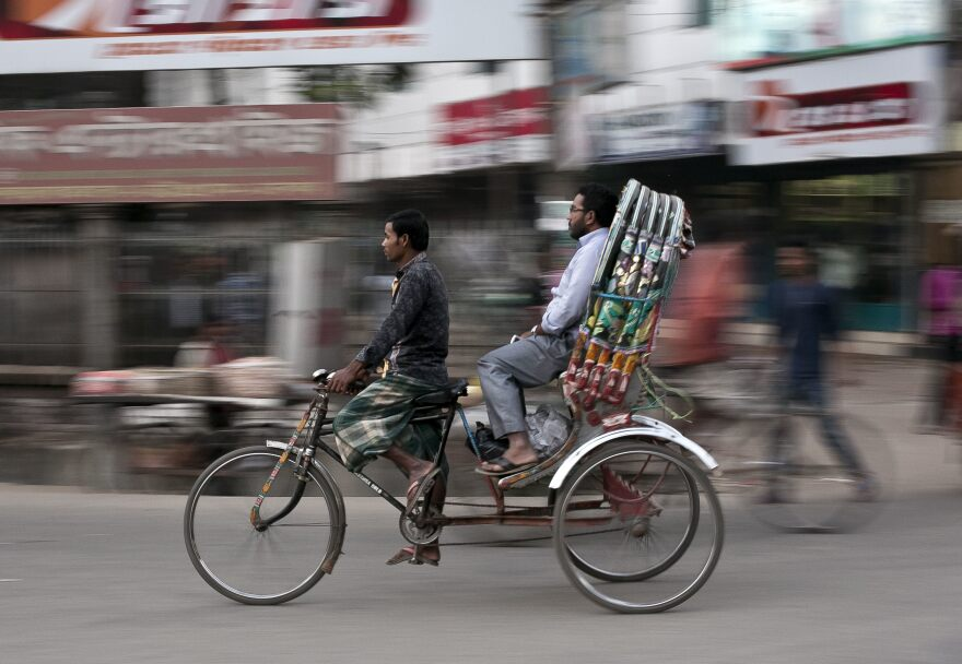 Low wages and a lack of formal jobs at home push millions of Bangladeshis to seek work abroad.  Rickshaw drivers hustle to earn a $5 or $6 a day. The minimum wage in Bangladesh's largest industry, textiles, is just $95 per month.