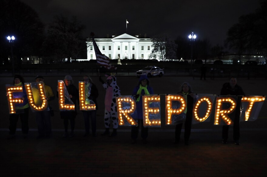 "Members of the protest group Herndon Reston Indivisible and Kremlin Annex hold signs saying ""Full Report,"" outside the White House in Washington, Monday, March 25, 2019. (Jacquelyn Martin/AP)"
