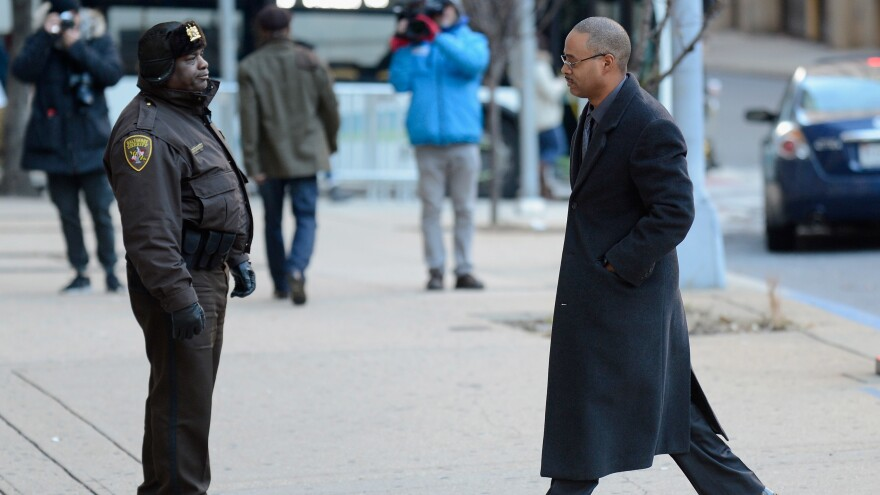 Baltimore police Officer Caesar Goodson (right) walks past Deputy Donald Rheubottom before entering a courthouse in Baltimore in January. Goodson, one of six Baltimore police officers charged in connection with the death of Freddie Gray, goes on trial starting Thursday.