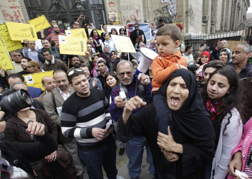 An Egyptian woman shouts anti-military Supreme Council slogans during a demonstration in front of Cairo's high court on Friday.