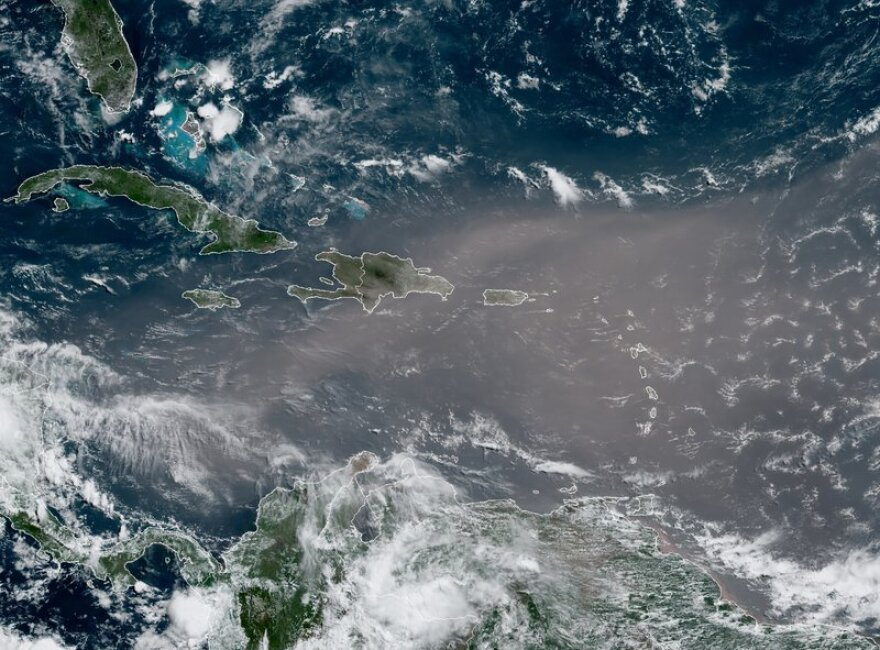 The massive cloud of dust is blanketing the Caribbean as it heads to the U.S. with a size and concentration level that meteorologists say hasn't been seen in roughly half a century.