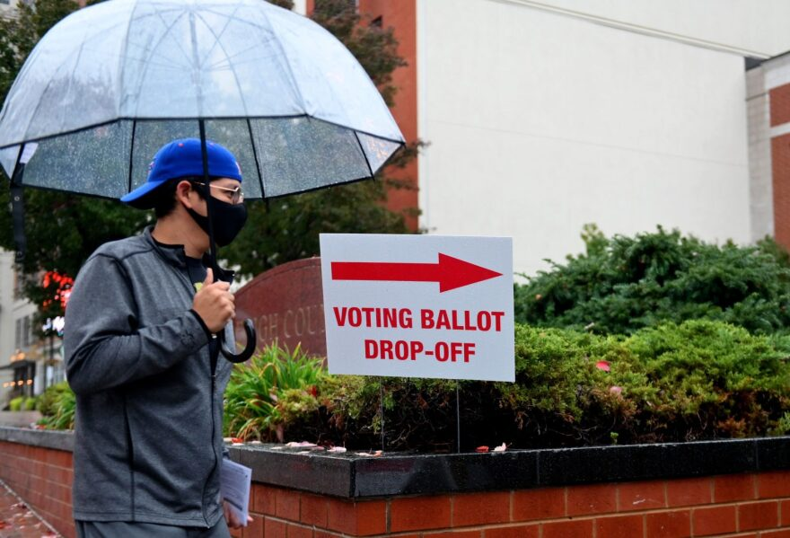 A voter arrives to drop off his ballot during early voting in Allentown, Pennsylvania.