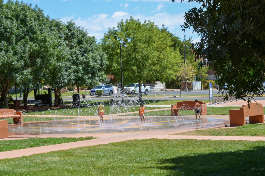 Photo of children playing on a splash pad outside