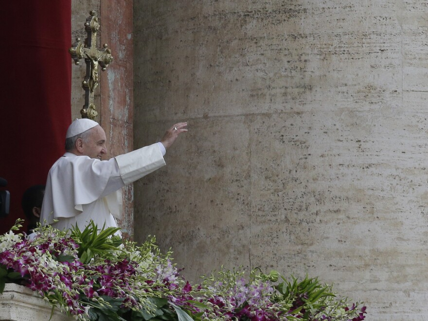 Pope Francis delivers the <em>Urbi et Orbi</em> blessing at the end of the Easter Sunday Mass in St. Peter's Square at the Vatican, on Sunday.