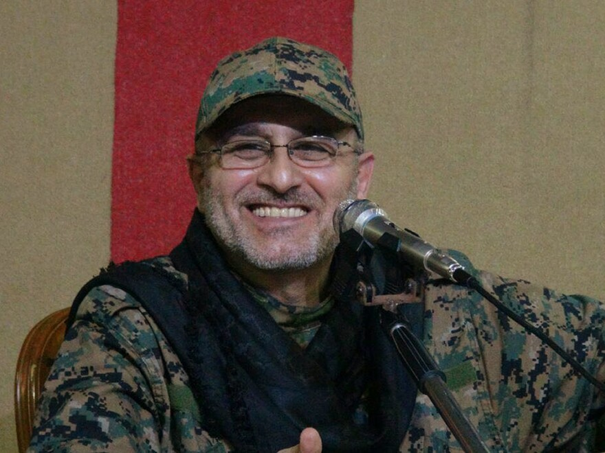 Slain Hezbollah top military commander Mustafa Badreddine smiling during a meeting in a photo released by the group Friday.