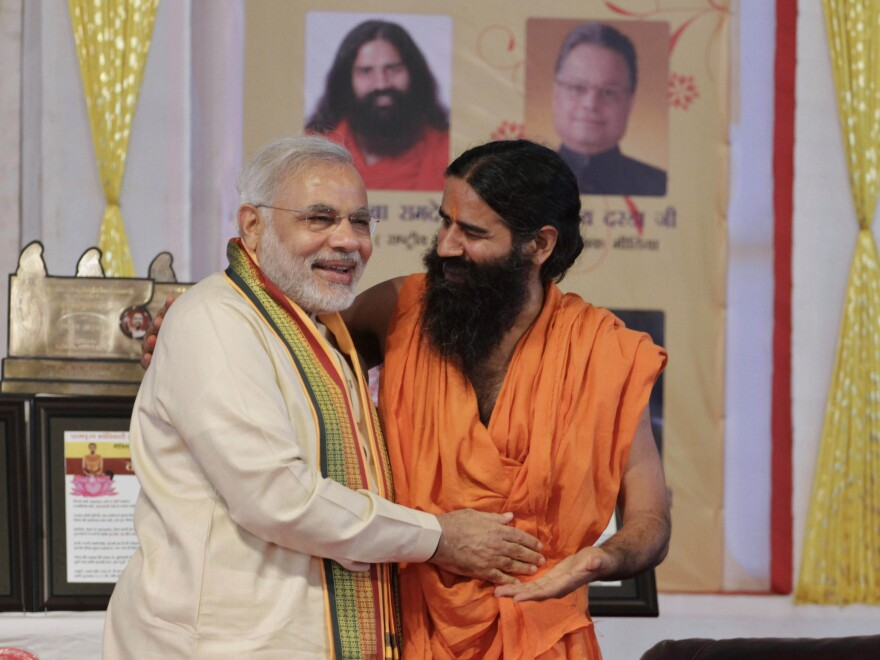 Baba Ramdev, shown here with Narendra Modi in 2012, campaigned for Modi when he first ran for prime minister five years ago.