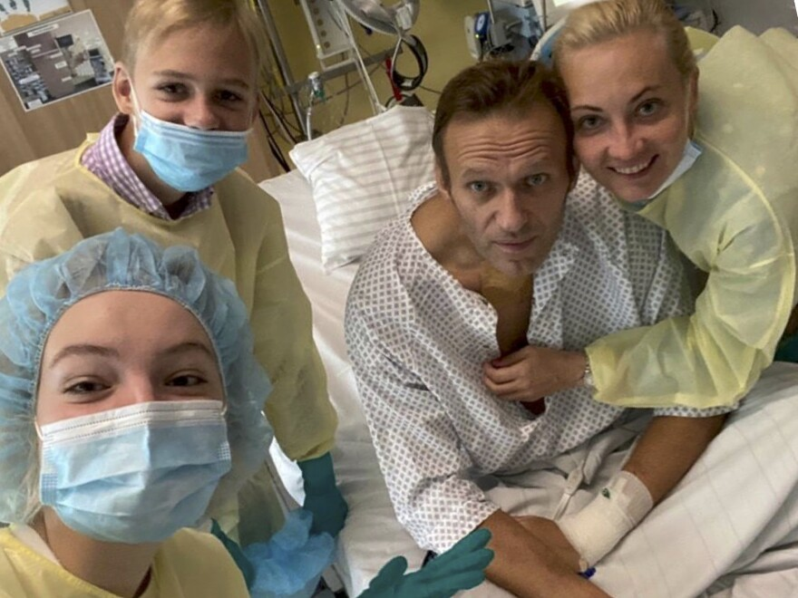 Russian opposition leader Alexei Navalny posted a photo of himself with daughter Daria, son Zahar and wife Yulia on his Instagram account Tuesday from his hospital bed in Berlin.
