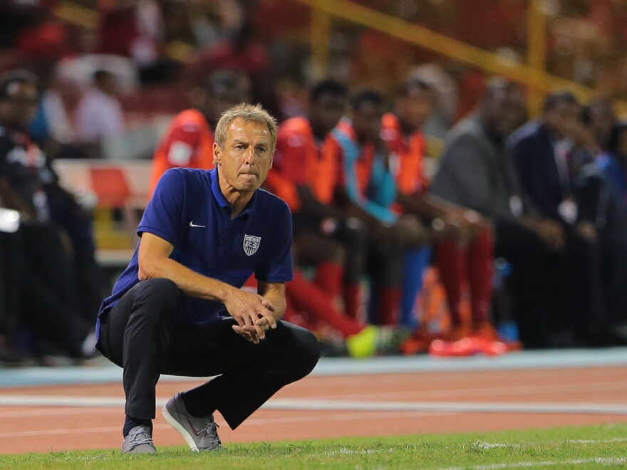 U.S. coach Jürgen Klinsmann studies the play during a World Cup qualifier between his squad and Trinidad and Tobago in November in Port of Spain, Trinidad and Tobago.
