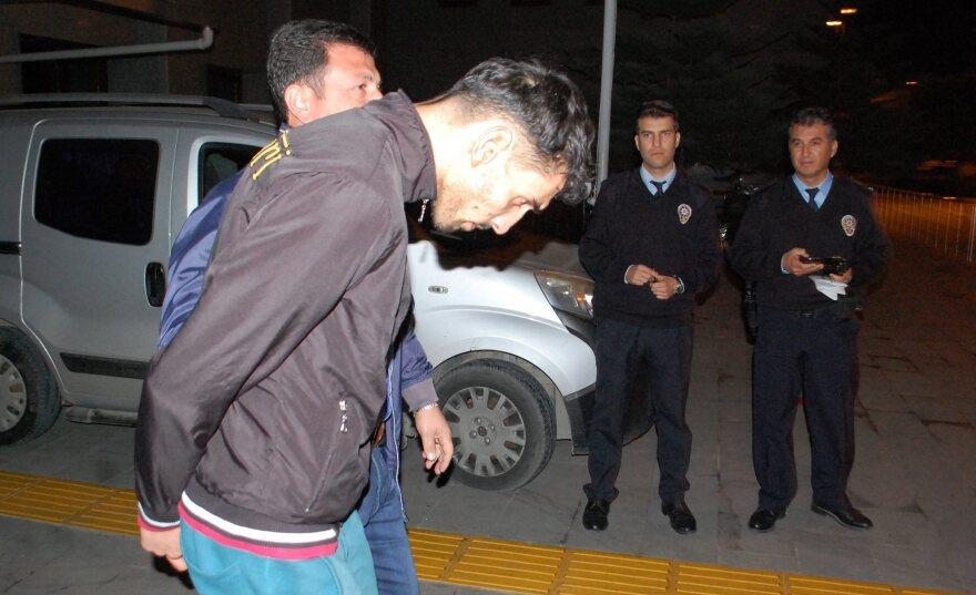 Anti-terror police detain a man identified as Ahmet Dahmani, an alleged ISIS member, in Antalya, Turkey, Saturday. One of three people arrested, Dahmani is accused of scouting locations for last week's terror attacks in Paris.