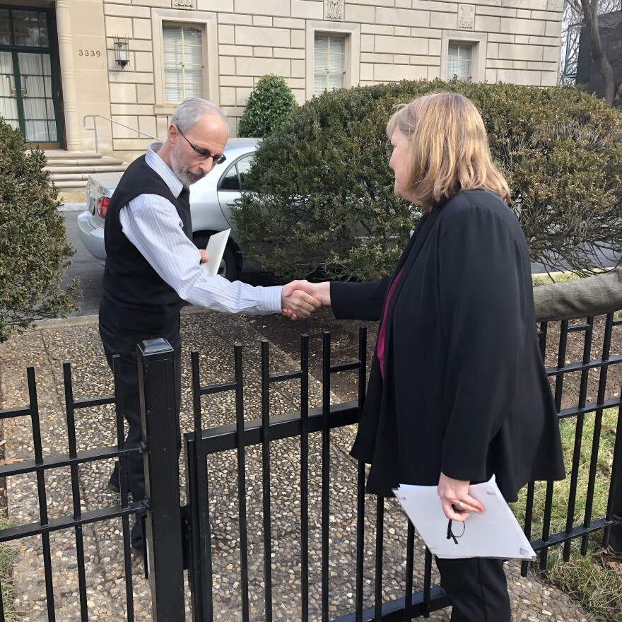 Clergy abuse survivor Becky Ianni (right) delivers a letter to the Vatican Embassy in Washington, D.C., addressed to Pope Francis.