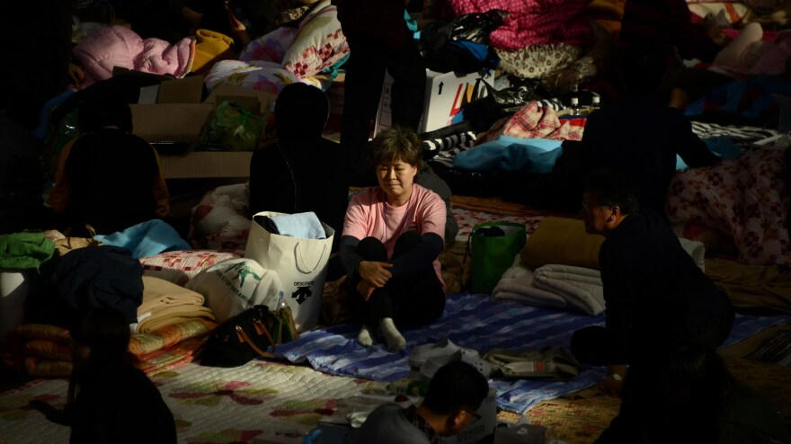 A relative sits in a gymnasium in Jindo, South Korea, where the families of people who are aboard the sunken South Korean ferry Sewol have gathered to await news from the recovery effort.