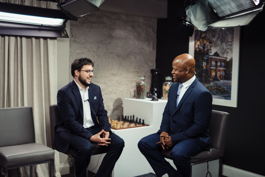 Grandmaster Maxime Vachier-Lagrave in conversation with Grandmaster Maurice Ashley. Vachier-Lagrave had a strong showing at the Grand Chess Tour's fourth leg, the St. Louis Rapid and Blitz in August 2019.