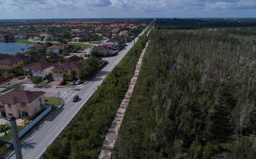Miami-Dade County transportation planners want to extend the Dolphin Expressway beyond the urban boundary shown here along Southwest 157th Avenue.