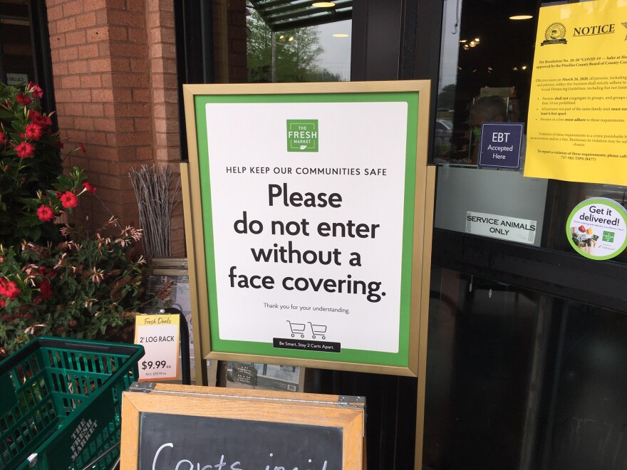 Sign says customers must wear face coverings