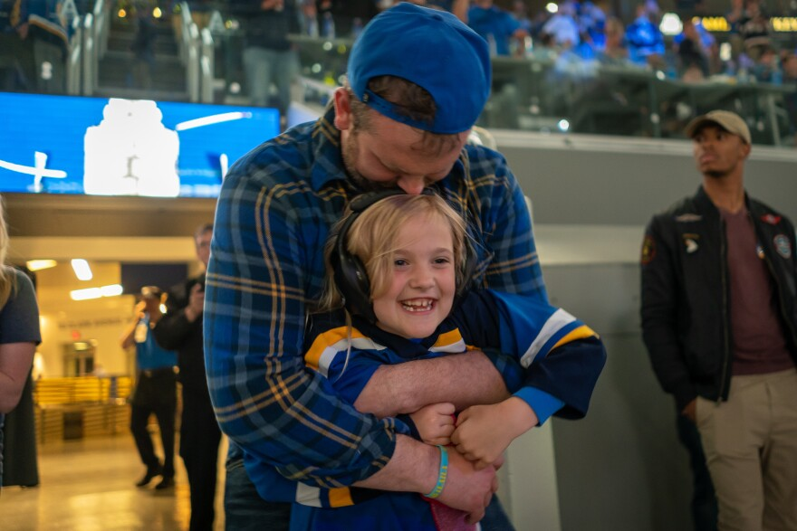 Emileigh White, 7, and her father, Daniel White, celebrate a Stanley Cup win by the St. Louis Blues Wednesday night. They joined thousands who watched the win on the video board at Enterprise Center in St. Louis. June 12, 2019
