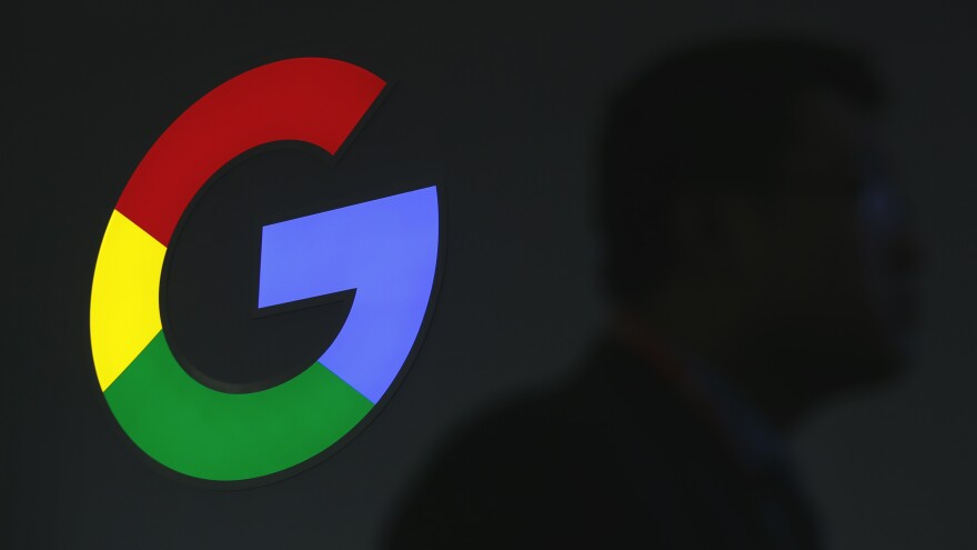 The Google sign is pictured at the Mobile World Congress in Barcelona on Monday.