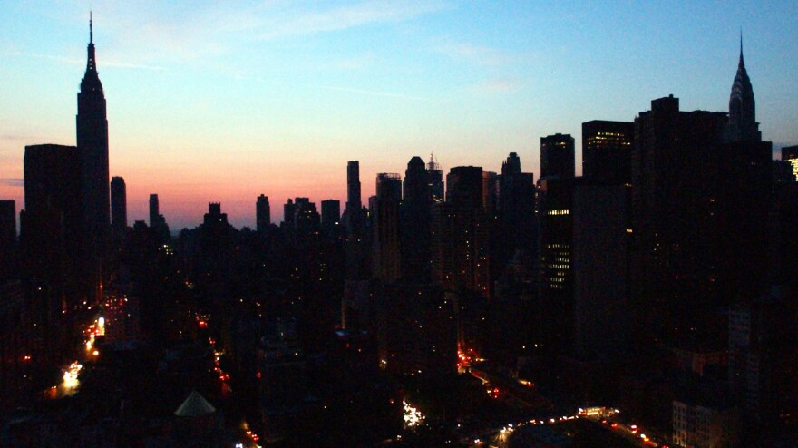 The New York City skyline is mostly dark in this photo of the 2003 blackout that hit U.S. and Canadian cities.
