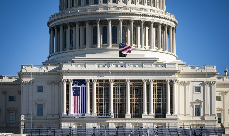The American flag flies at half-staff on the West Front of the U.S. Capitol on Saturday. Monday, House Democrats introduced an impeachment resolution against President Trump for his role in last week's insurrection.