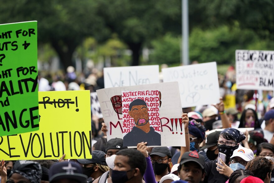 People gather to protest the death of George Floyd in Houston on Tuesday, June 2, 2020.