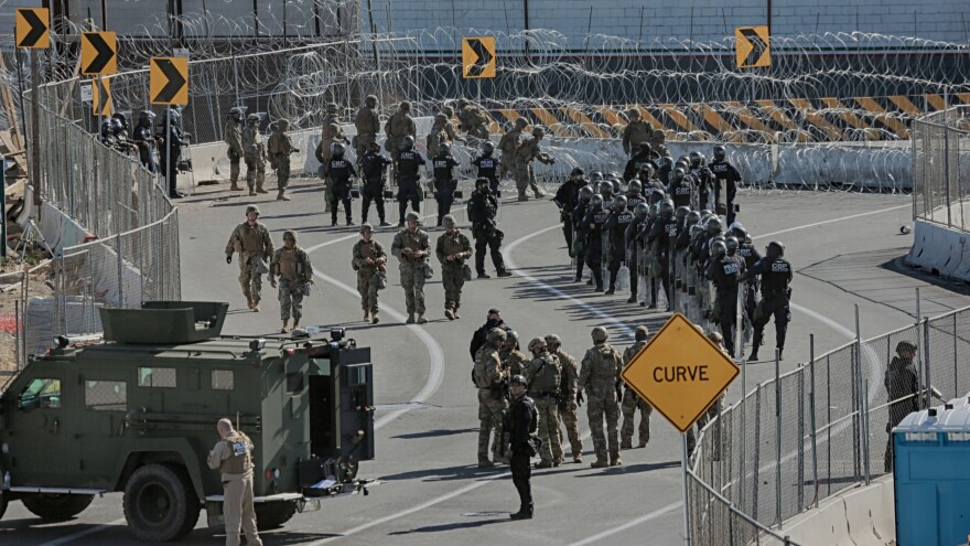 U.S. military personnel and Border Patrol agents secure the border at the San Ysidro crossing point.